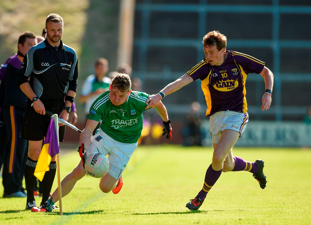 Aidan Breen of Fermanagh in action against Kevin O'Grady of Wexford. Photo by Diarmuid Greene/Sportsfile