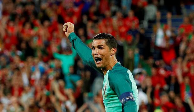 Portugal's Cristiano Ronaldo celebrates after Ricardo Quaresma scores their first goal. Photo: Lee Smith/Reuters