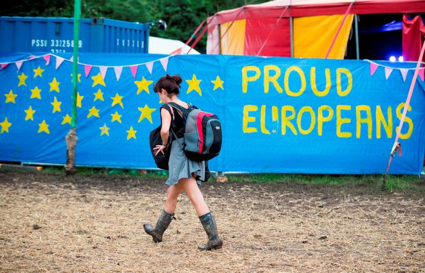 A festival-goer at Glastonbury passes a pro-EU banner. Photo: Matt Cardy/Getty Images