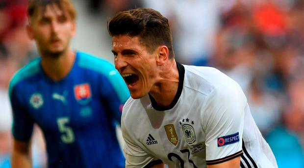 Germany's forward Mario Gomez celebrates after scoring his goal. Photo: Patrik Stollarz/AFP/Getty Images