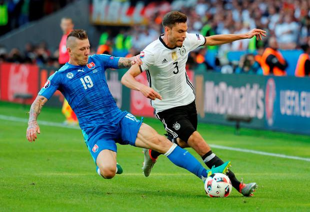 Germany's Jonas Hector in action with Slovakia's Juraj Kucka. Photo: Pascal Rossignol/Reuters