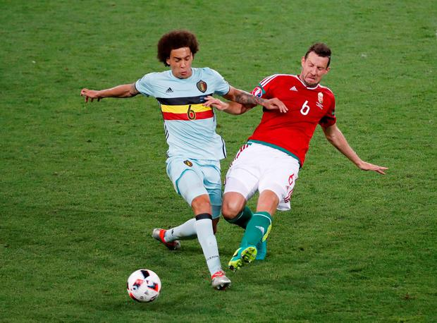 Belgium's Axel Witsel in action with Hungary's Akos Elek. Photo: Vincent Kessler/Reuters