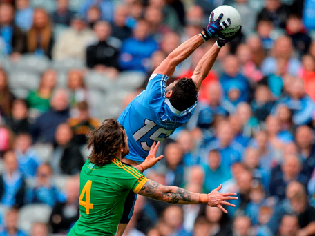 Dublin's Bernard Brogan makes a high catch under pressure from Meath's Mickey Burke at Croke Park. Photo: Piaras Ó Mídheach/Sportsfile