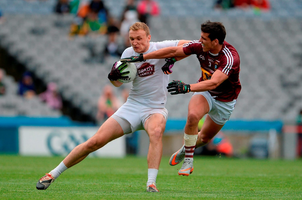 Tommy Moolick of Kildare in action against Denis Corroon of Westmeath. Photo by Oliver McVeigh/Sportsfile