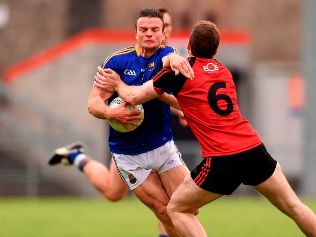 Longford's Donal McElligott in action against Down's Aidan Carr. Photo: Paul Mohan/Sportsfile