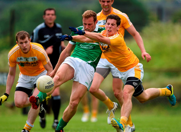 Limerick's Darragh Treacy has a shot at goal charged down by Antrim's Kevin O'Boyle. Photo: Ramsey Cardy/Sportsfile