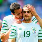 John O'Shea – after what may prove to be his final game for Ireland – consoles Robbie Brady following the 2-1 defeat to France in Lyon yesterday. Photo: Laurence Griffiths/Getty Images