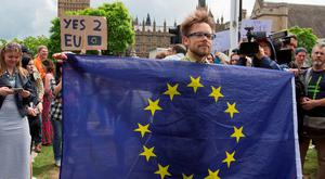 A protester holding an EU flag demonstrates against the referendum result in London. Photo: Jason Alden/Bloomberg