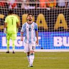 Argentina midfielder Lionel Messi (10) reacts after missing a shot during the penalty shootout