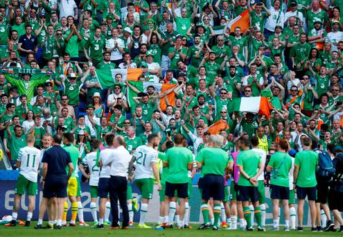 The Irish squad acknowledge the support of their fans after the match. Photo: Reuters
