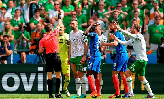 Shane Duffy of Republic of Ireland receives a red card from referee Nicola Rizzoli from Italy during the UEFA Euro 2016 Round of 16 match between France and Republic of Ireland at Stade des Lumieres in Lyon, France. Photo by Stephen McCarthy/Sportsfile
