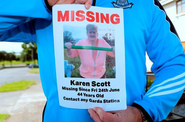 Next-door neighbour Robert Burke holds a Missing flyer for Karen Scott, missing since Friday 24th June. Barnamore Grove, Finglas, Dublin. Picture: Caroline Quinn