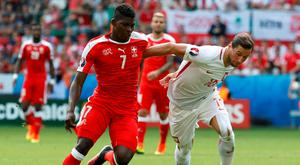 Football Soccer - Switzerland v Poland - EURO 2016 - Round of 16 - Stade Geoffroy-Guichard, Saint-Étienne, France - 25/6/16 Switzerland's Breel Embolo in action with Poland's Grzegorz Krychowiak REUTERS/Yves Herman Livepic