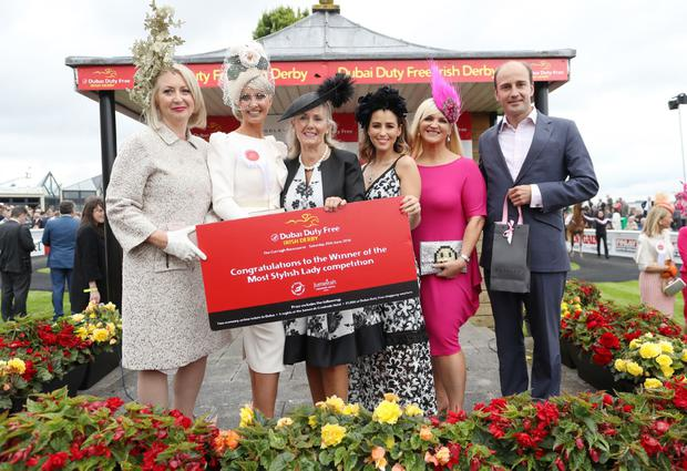 The Curragh racecourse was winner Eva Hayes Morrissey from Castletroy Co.Limerick (2nd left) with L-R Bairbre Power (Judge) ,Breeda McLoughlin (Dubai Duty Free),Rachel Stevens (Judge),Melanie Morris (Judge) and James Amos (Boodles) as she wins the Most Stylish Lady Competition at the 2016 Dubai Duty Free Irish Derby.