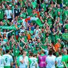 Ireland players and staff see their fans applauding them at the end of the game following the round of 16 match at the Stade de Lyon