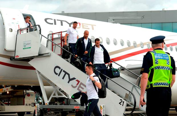Robbie Keane, front, John O'Shea, Darren Randolph, Jonathan Walters, and Stephen Quinn of Republic of Ireland on their arrival back from UEFA Euro 2016 on CityJet's new Superjet. CityJet is the official partner to the FAI. Dublin Airport, Dublin. Photo by Piaras Ó Mídheach/Sportsfile