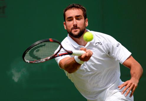 Croatia's Marin Cilic in action during his match against USA's Brian Baker