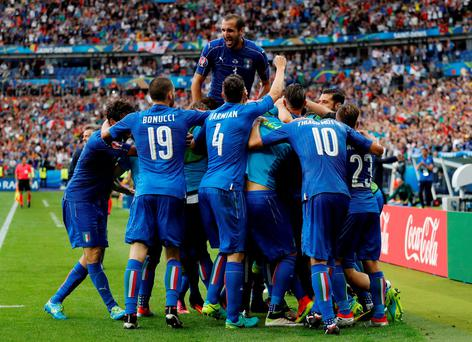 Italy's Graziano Pelle celebrates with teammates after scoring their second goal