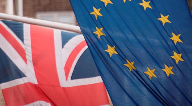 A Union Jack hangs alongside an EU Flag. Photo: PA
