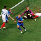 Iceland's Ragnar Sigurdsson celebrates scoring their first goal