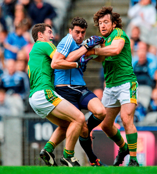 Padraic Harnan and Mickey Burke attempt to crowd out Bernard Brogan. Photo: Piaras Ó Mídheach/Sportsfile
