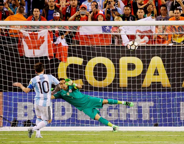 Lionel Messi's penalty flies over the crossbar during Argentina's shoot-out defeat in the Copa America final against Chile in New Jersey Photo: AP