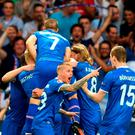 Iceland's forward Kolbeinn Sigthorsson (2L) celebrates after scoring