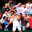 England's Marcus Willis, World No 772, celebrates with friends after his victory over 54th-ranked Ricardas Berankis. Photo by Jordan Mansfield/Getty Images
