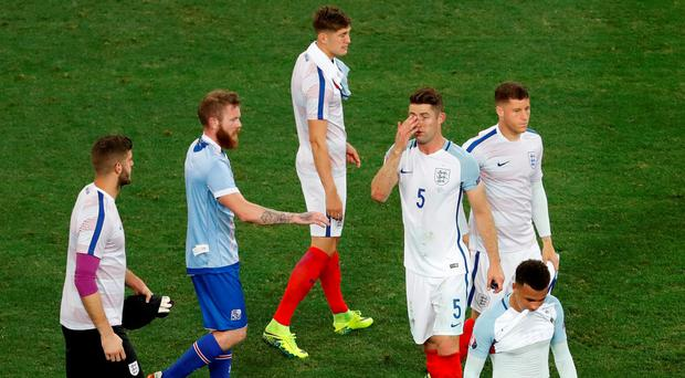 England's Gary Cahill looks dejected at the end of the game