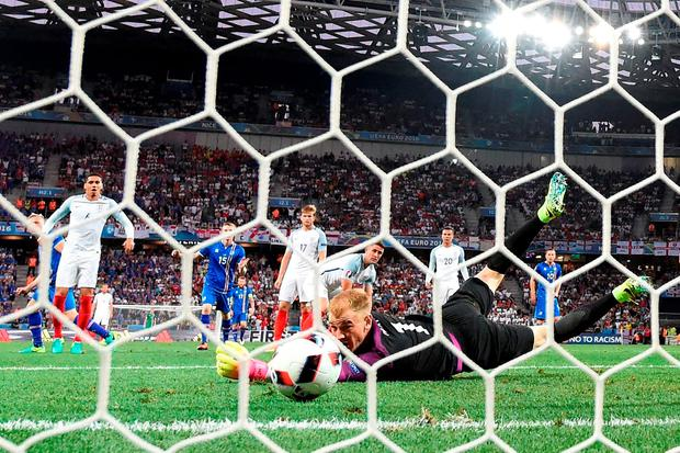 England's goalkeeper Joe Hart fails to stop the shot from Iceland's forward Kolbeinn Sigthorsson squirming past him Photo: PAUL ELLIS/AFP/Getty Images
