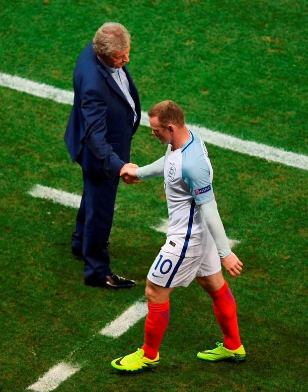 Roy Hodgson - who resigned after last night's defeat - shakes hands with Wayne Rooney after his substitution Photo: Laurence Griffiths/Getty Images