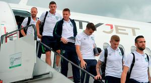 The Republic of Ireland's Séamus Coleman (r), James McCarthy (c) and Ciarán Clark depart the plane after their arrival at Dublin Airport yesterday. Pic: Sportsfile