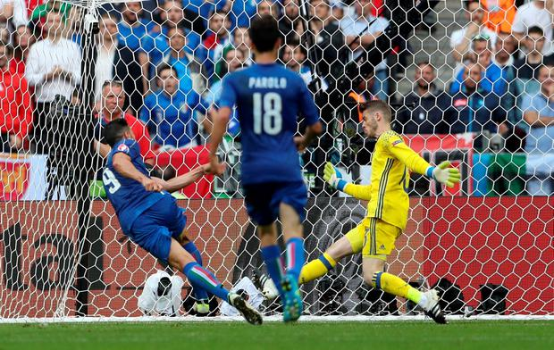 Graziano Pelle puts away the second goal for Italy Photo: REUTERS/Lee Smith