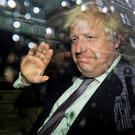 Boris Johnson waves as leaves his home by car in London yesterday. Photo by Jack Taylor/Getty Images