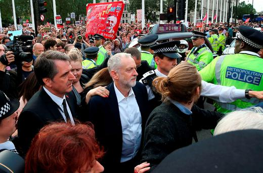 Leader of the opposition Labour Party Jeremy Corbyn (C) leaves after delivering a speech outside parliament during a pro-Corbyn demonstration in central London. Getty Images