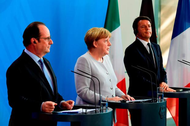 (L-R) French President Francois Hollande, German Chancellor Angela Merkel and Italy's Prime Minister Matteo Renzi address a press conference ahead of talks following the Brexit referendum at the chancellery in Berlin. Getty Images