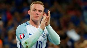 Wayne Rooney applauds the England fans at the end of the game