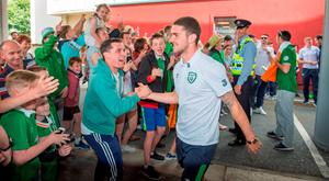 Ireland hero Robbie Brady is greeted by a fan at Dublin Airport. Photo: Barry Cronin/PA Wire