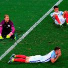 England goalkeeper Joe Hart (left) England's Gary Cahill (bottom) and England's Dele Alli show their dejection after the final whistle