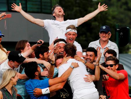 Great Britain's Marcus Willis celebrates with friends after winning his match against Lithuania's Ricardas Berankis. Picture: REUTERS/Stefan Wermuth