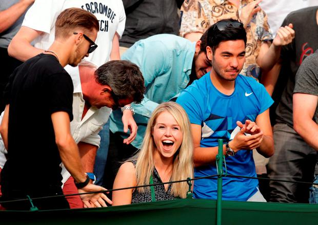 Marcus Willis' girlfriend Jenny Bate celebrates his victory over Ricardas Berankis on day One of the Wimbledon Championships