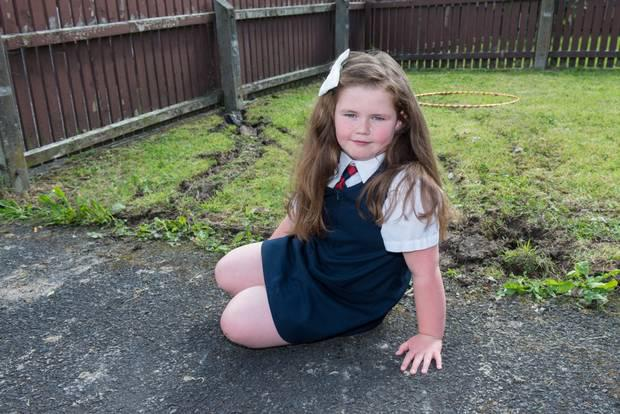 Hannah McCready from Ballymore Park in Derry was playing with her hula hoop moments before a stolen car crashed into her garden