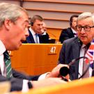 European Commission President Jean-Claude Juncker, right, speaks with UKIP leader Nigel Farage during a special session of European Parliament in Brussels on Tuesday, June 28, 2016. (AP Photo/Geert Vanden Wijngaert)