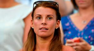 Coleen Rooney, wife of England's forward Wayne Rooney, attends the Euro 2016 round of 16 football match between England and Iceland at the Allianz Riviera stadium in Nice