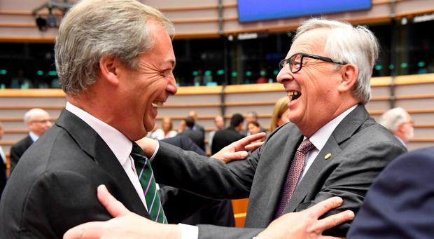 European Commission President Jean-Claude Juncker, right, greets UKIP leader Nigel Farage during a special session of European Parliament in Brussels (AP Photo/Geert Vanden Wijngaert)