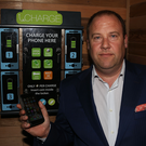 Patrick Cotter, CEO of FleetConnect, with the iCharge secure box