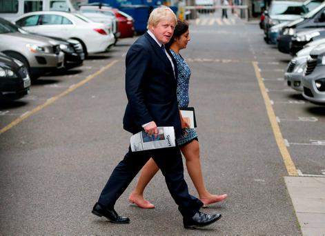 Boris Johnson – seen here walking across a car park by the Houses of Parliament in London yesterday – should be on the next flight to Berlin. Photo: Getty Images