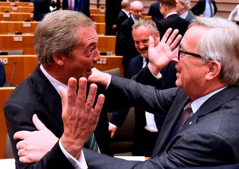 European Commission president Jean-Claude Juncker has words with Ukip's Nigel Farage at the European Parliament. Photo: Reuters