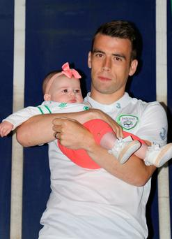 An emotional Seamus Coleman with five-month-old daughter Lilly at his homecoming reception in Killybeggs