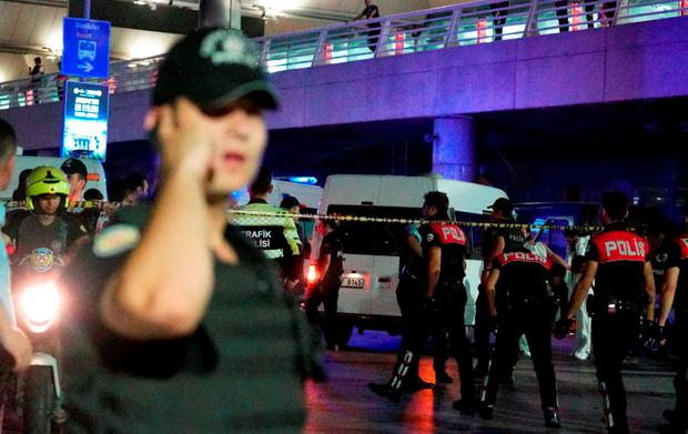Turkish security officers gather outside Turkey's largest airport, Istanbul Ataturk. Three suicide bombers opened fire before blowing themselves up at the entrance to the main international airport in Istanbul, killing at least 28 people and wounding at least 60 people, according to Istanbul governor Vasip Sahin. (Photo by Mehmet Ali Poyraz/Getty Images)